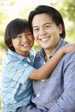 Portrait Asian father and son outdoors Royalty Free Stock Photo