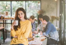 Portrait of asian female creativity working team coworking office ,Smiling of happy beautiful woman Hand Holding Coffee Cup