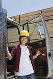 Portrait of an Asian female industrial worker standing by vehicle door Stock Photography