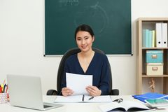 Portrait of Asian female teacher in classroom royalty free stock photo
