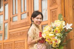 Portrait of Asian female in traditional dresses pose at Thai home. stock images