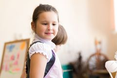 Portrait of Asian girl in apron painting Stock Photo