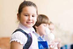 Portrait of Asian girl in apron painting Stock Images