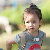 Portrait of Asian girl with backpack outdoor. Royalty Free Stock Photos