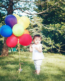 Portrait of asian girl with balloons Stock Images
