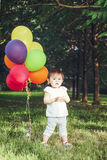Portrait of asian girl with balloons Royalty Free Stock Images