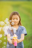Portrait of asian girl blowing soap bubbles Royalty Free Stock Photography