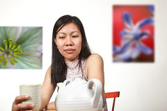 Portrait of an asian girl drinking tea Royalty Free Stock Image