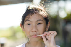 Portrait of Asian girl eating an ice-cream. Royalty Free Stock Photos