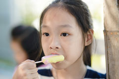 Portrait of Asian girl eating an ice-cream. stock photo