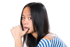 Portrait of Asian girl with a finger on a lip Stock Images