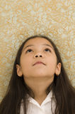 Portrait of Asian Girl Looking Up Stock Photo