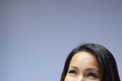 Portrait of Asian girl looking up and smiling Stock Photography
