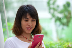 Portrait Asian girl with mobile Stock Photography