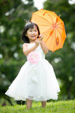 Portrait of asian girl in the park green background, Royalty Free Stock Photos