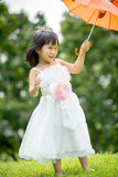 Portrait of asian girl in the park green background, Royalty Free Stock Image