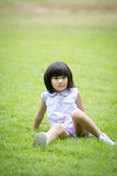 Portrait of asian girl in the park green background, Stock Photography