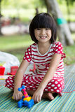 Portrait of asian girl in the park green background, Stock Image