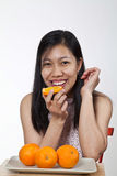 Portrait of an asian girl with a plate of oranges Royalty Free Stock Photo