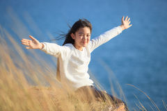 Portrait of asian girl relaxing emotion sitting in grass field a Stock Photo