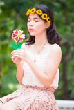 Portrait asian girl with toy flower Stock Photos