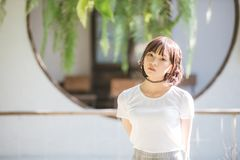 Portrait of asian girl with white shirt looking in outdoor nature vintage film style stock images