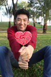 Portrait of asian guy with lollipop Stock Images