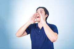 Portrait of Asian guy yelling, screaming, shouting, hand on his Stock Images