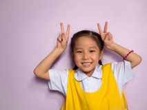 Portrait of Asian happy little girl , smile. School uniform Royalty Free Stock Images