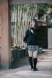 Portrait Asian japanese school girl costume in bamboo japanese garden. In close up royalty free stock photos