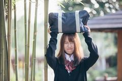 Portrait Asian japanese school girl costume in japanese garden. In close up stock images