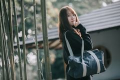 Portrait Asian japanese school girl costume in japanese garden. In close up stock photos