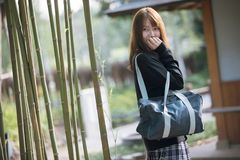 Portrait Asian japanese school girl costume in japanese garden. In close up stock photo