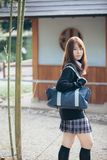 Portrait Asian japanese school girl costume in japanese garden. In close up stock photography