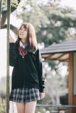 Portrait Asian japanese school girl costume in japanese garden. In close up royalty free stock images