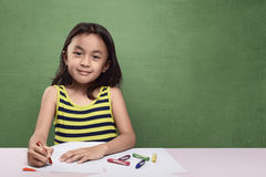 Portrait of asian kid drawing with colorful crayon Stock Images