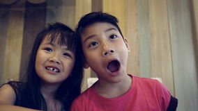Portrait of asian kids, happy asian boy and girl looking at camera and smiling. Sequence stock footage
