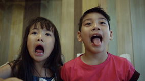 Portrait of asian kids, happy asian boy and girl looking at camera and smiling. Sequence stock video