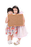 Portrait of Asian little girl hold wood board on white backgroun Royalty Free Stock Images