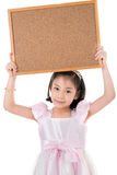 Portrait of Asian little girl hold wood board on white backgroun Royalty Free Stock Photo