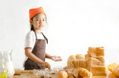 Portrait of Asian little girl holding dough in hand with copy sp Stock Photo