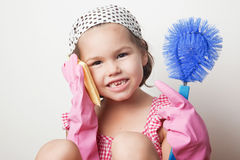 Portrait of asian little girl, little mother`s helper Royalty Free Stock Photography