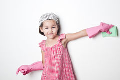 Portrait of asian little girl, little mother`s helper Royalty Free Stock Image
