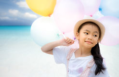 Portrait of asian little girl playing with air balloons Stock Photo