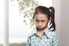 Portrait of asian little girl with unhappy face Royalty Free Stock Photo