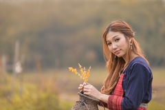 Portrait of Asian longhair young lady in tribe dress sit near sw royalty free stock photo