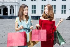 Portrait of asian luxury woman with some shopping bags. Portrait of asian luxury women with some shopping bags on the city stock photography