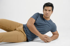Portrait of an Asian man. A portrait of a tanned Asian man in a reclined position royalty free stock photography