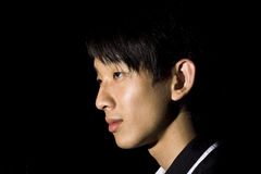 Portrait of an Asian man in the darkness Stock Images