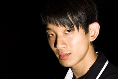 Portrait of an Asian man in the darkness Royalty Free Stock Image